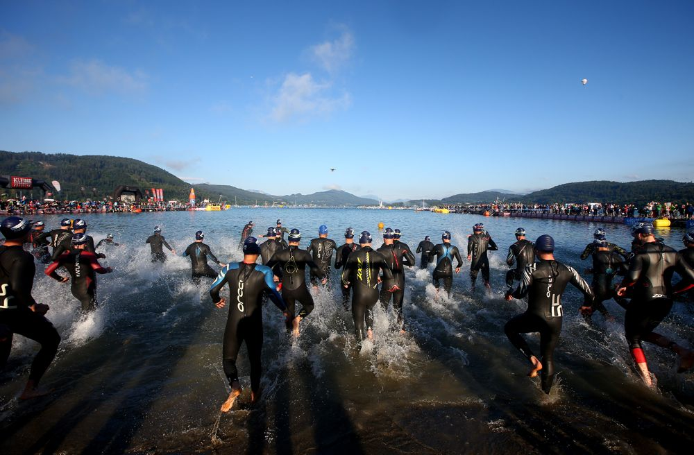 KLAGENFURT, AUSTRIA - JUNE 28: Participants begin the race with the swim leg during Ironman Klagenfurt on June 28, 2015 in Klagenfurt, Austria. (Photo by Charlie Crowhurst/Getty Images for Ironman) *** Local Caption ***