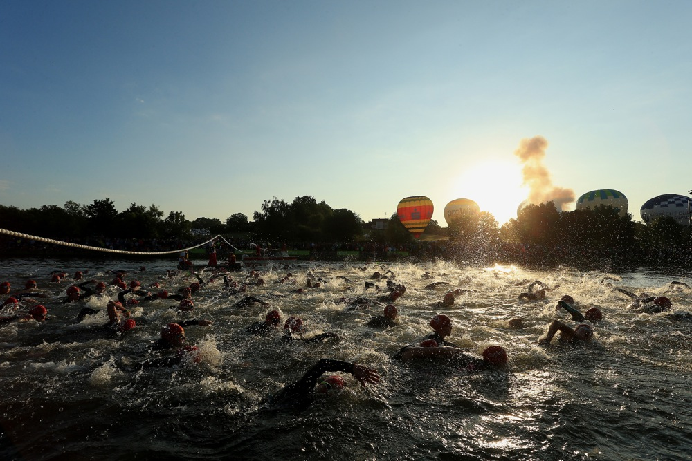 ROTH, GERMANY - JULY 12:  Athletes begin the race at the swim start during the Challenge Triathlon Roth on July 12, 2015 in Roth, Germany. (Photo by Stephen Pond/Getty Images for Challenge Triathlon)