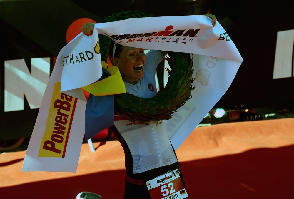 KALMAR, SWEDEN - AUGUST 15:  Astrid Stienen of Germany celebrates winning the women's race at Ironman Kalmar on August 15, 2015 in Kalmar, Sweden.  (Photo by Nigel Roddis/Getty Images for Ironman)