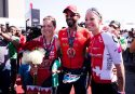 BAHRAIN, BAHRAIN - NOVEMBER 25: HH Sheikh Nasser Bin Hamad Al Khalifa is congratulated by Holly Lawrence (L) of Great Britain and Daniela Ryf (R) of Switzerland after finishing the men's race of IRONMAN 70.3 Middle East Championship Bahrain on November 25, 2017 in Bahrain, Bahrain. (Photo by Alex Caparros/Getty Images for IRONMAN)
