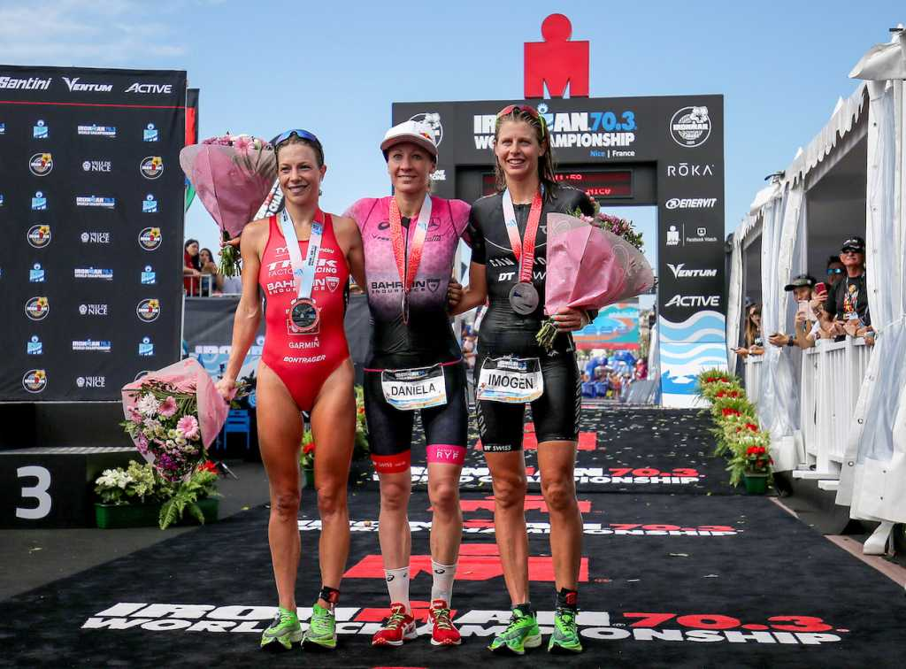 NICE, FRANCE - SEPTEMBER 07: Daniela Ryf of Switzerland (C), Holly Lawrence of Britain (L) and Imogen Simmonds of Switzerland (R) on the podium of Ironman 70.3 World Championship Women's race on September 7, 2019 in Nice, France. (Photo by Nigel Roddis/Getty Images for IRONMAN)