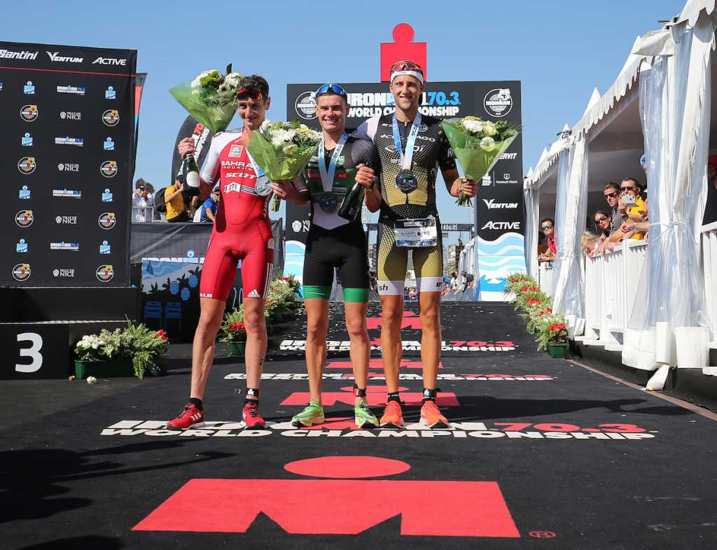 NICE, FRANCE - SEPTEMBER 08:  Gustav Iden of Norway  (C), Alistair Brownlee of Britain (L) and Rodolphe Von Berg of USA (R) pose for media after finishing Ironman 70.3 World Championship Men's race on September 8, 2019 in Nice, France. (Photo by Nigel Roddis/Getty Images for IRONMAN)