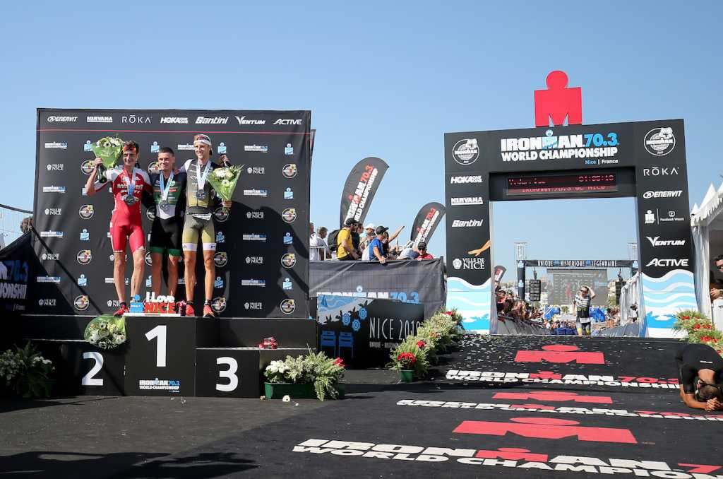 NICE, FRANCE - SEPTEMBER 08:  Gustav Iden of Norway   (C), Alistair Brownlee of Britain (L) and Rodolphe Von Berg of USA (R) on the podium of Ironman 70.3 World Championship Men's race on September 8, 2019 in Nice, France. (Photo by Nigel Roddis/Getty Images for IRONMAN)