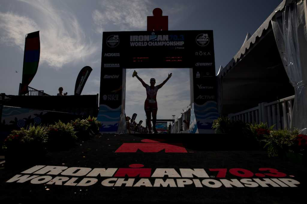 NICE, FRANCE - SEPTEMBER 07: An athlete celebrates crossing the finish line of IRONMAN 70.3 World Championship Women on September 07, 2019 in Nice, France. (Photo by Pablo Blazquez Dominguez/Getty Images for IRONMAN)